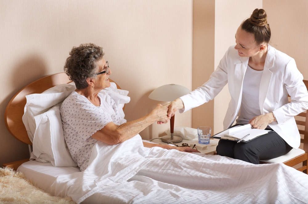 a social worker and a patient shaking hands